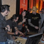 Ric Viers, Erik Steele, Lin Zy and Matt Busch sign posters after an Aladdin 3477 presentation at Full Sail University.